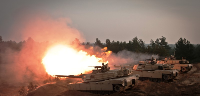 Soldiers from Company C, 2nd Battalion, 8th Cavalry Regiment, 1st Brigade Combat Team, 1st Cavalry Division fire rounds from their M1A2 Abrams Tanks at the Adazi Training Area, Latvia, Nov. 6, 2014. The Soldiers, who were here to assist in training the Latvian Land Forces as part of Operation Atlantic Resolve, were part of an exhibit to dignitaries and local media. These rounds mark the first firing of tank rounds in Latvia since 1994. These activities were part of the U.S. Army Europe-led Operation Atlantic Resolve land force assurance training taking place across Estonia, Latvia, Lithuania and Poland to enhance multinational interoperability, strengthen relationships among allied militaries, contribute to regional stability and demonstrate U.S. commitment to NATO. (U.S. Army photo by Sgt. 1st Class Jeremy J. Fowler)