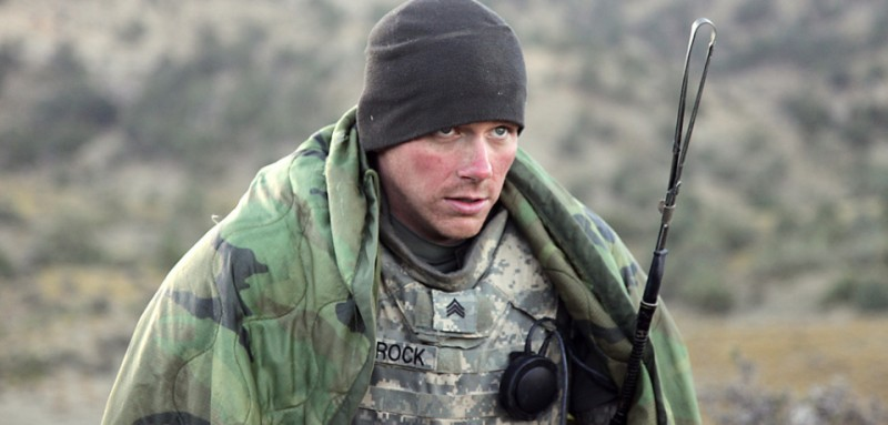 U.S. Army Sgt. Nathan Schrock, from Arthur, Ill., tries to keep warm after waking up on a cold morning in the mountains near Sar Howza, Paktika province, Afghanistan, Sept. 4. Schrock is deployed with Bulldog Troop, 1st Squadron, 40th Cavalry Regiment.