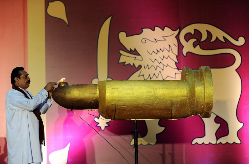 Sri Lanka's former president Mahinda Rajapaksa lights a lamp in Colombo on May 18, 2015 in commemoration of those who died six years ago in battles between Liberation Tigers of Tamil Eelam (LTTE) fighters and government troops at the end of the three decades old separatist conflict.  Rajapaksa urged against any separatist wars in the future. The sixth anniversary of the killing of Liberation Tigers of Tamil Eelam (LTTE) leader Velupillai Prabhakaran is being marked in the first anniversary of the event under the new government of President Sirisena. AFP PHOTO / ISHARA S. KODIKARA        (Photo credit should read Ishara S.KODIKARA/AFP/Getty Images)