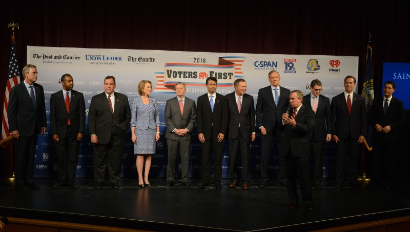 MANCHESTER, NH - AUGUST 3: Saint Anselm College President Steven R. DiSalvo introduces (L-R) former Florida Gov. Jeb Bush, Dr. Ben Carson, New Jersey Gov. Chris Christie, former CEO Hewlett-Packard Carly Fiorina, U.S. Senator Lindsey Graham (SC), Louisiana Gov. Bobby Jindal, Ohio Gov. John Kasich, former New York Gov. George Pataki, former Texas Gov. Rick Perry, former U.S. Senator Rick Santorum (PA), Wisconsin Gov. Scott Walker stand on the stage prior to the Voters First Presidential Forum at Saint Anselm College August 3, 2015 in Manchester, New Hampshire. The forum was organized by the New Hampshire Union Leader newspaper and C-SPAN in response to the Fox News debate later this week that will limit the candidates to the top 10 Republicans based on nationwide polls. (Photo by Darren McCollester/Getty Images)