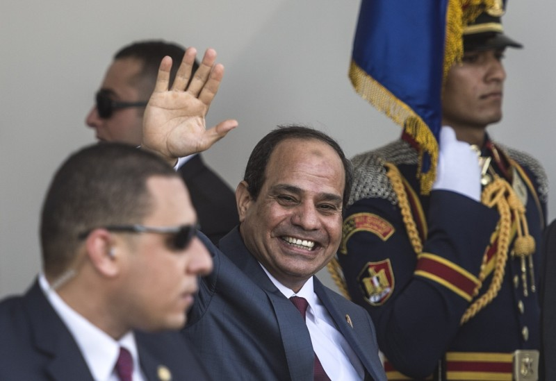 "Egyptian President Abdel Fattah al-Sisi  waves as he arrives for the opening ceremony of a new waterway at the Suez Canal on August 6, 2015, in the port city of Ismailiya. Sisi staged a lavish ceremony to unveil a ""new"" Suez Canal, seeking to boost the country's economy and international standing by expanding the vital waterway.  AFP PHOTO/ KHALED DESOUKI        (Photo credit should read KHALED DESOUKI/AFP/Getty Images)"