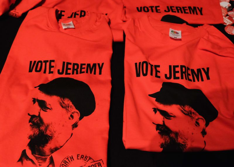 MIDDLESBROUGH, ENGLAND - AUGUST 18:  Memorabilia supporting British Labour Party leadership contender Jeremy Corbyn is offered for sale ahead of his arrival to address party supporters as part of a nationwide leadership campaign at the Town Hall on August 18, 2015 in Middlesbrough, England. The Labour party leadership election was triggered by the resignation earlier in the year of Ed Miliband following the party's defeat at the general election. Four candidates were successfully nominated to stand, Andy Burnham, Yvette Cooper, Jeremy Corbyn and Liz Kendall. The result of the campaign will be announced on Saturday 12 September 2015.  (Photo by Ian Forsyth/Getty Images)