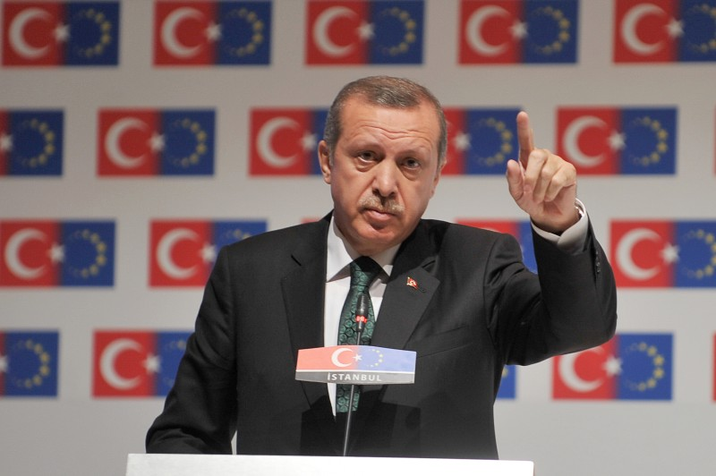 "Turkey Prime Minister Recep Tayyip Erdogan speaks during the opening session of the Ministry For European Union Affairs Conference on June 7, 2013, in Istanbul. Turkish Prime Minister Recep Tayyip Erdogan said today his Islamic-rooted government was open to ""democratic demands"" and hit back at EU criticism of his government's handling of a week of deadly unrest. Amid international condemnation over rights abuses in the unrest, European Union Enlargement Commissioner Stefan Fule told Erdogan that excessive police force ""has no place"" in a democracy and urged a ""swift and transparent"" probe into the abuses, a longtime EU hopeful.  AFP PHOTO / STRINGER        (Photo credit should read STRINGER/AFP/Getty Images)"