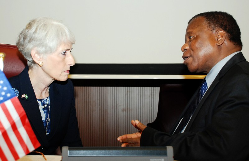 """US Under Secretary for Political Affairs Wendy Sherman (L) speaks Nigeria's ambassador to the United States Ade Adefuye attend a meeting in Abuja on August 15, 2013. Wendy Sherman said the United States was ready to help Nigeria """"develop a multi-faceted strategy"""" to contain the Boko Haram violence, but warned that a military crackdown alone would not work.      AFP PHOTO / PIUS UTOMI EKPEI        (Photo credit should read PIUS UTOMI EKPEI/AFP/Getty Images)"""