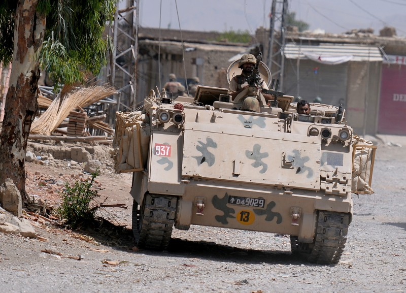 This photograph taken on July 9, 2014 shows Pakistani soldiers patrol during a military operation against Taliban militants, in the main town of Miranshah in North Waziristan.   Pakistan's military says its anti-militant offensive in a northwestern tribal area has now taken control of 80 percent of a strategic town, as a US drone strike on July 10 killed six suspected insurgents. AFP PHOTO/Aamir QURESHI        (Photo credit should read AAMIR QURESHI/AFP/Getty Images)