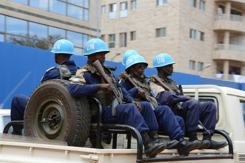 "This photo taken on October 3, 2014 shows the UN Minusca peacekeepers patrolling through the 3rd district of Bangui, following deadly clashes between armed groups in the Central African town of Bambari that have left at least 25 dead, and increasing security on the eve of the Muslim feast of Eid al-Adha. The region remains highly restive due to splits within the Seleka ""between a branch that is more and more radicalised and another which is more open to dialogue to exit the crisis,"" said Colonel Gilles Jaron of the French peacekeeping forces. AFP PHOTO / PACOME PABANDJI        (Photo credit should read PACOME PABANDJI/AFP/Getty Images)"