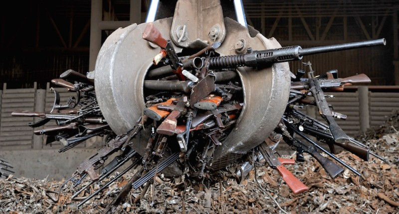 A crane carry part of 9,517 weapons seized from the FARC and ELN guerrillas criminal gangs and organized crime, before being melted in furnaces of the National Steel Factory (Sidenal), on November 25, 2014 in Sogamoso, Boyaca department, Colombia. The metal (iron and steel), obtained from these weapons will be used in the manufacture of rods used to reinforce the foundations and columns of schools and hospitals in areas of armed conflict. AFP PHOTO/Guillermo LEGARIA        (Photo credit should read GUILLERMO LEGARIA/AFP/Getty Images)