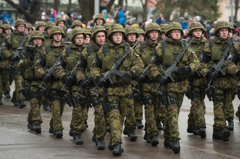 Estonian soldiers take part in a military parade to celebrate 97 years since first achieving independence in 1918 on February 24, 2015 in Narva, Estonia. The town, on Estonia's border with Russia, has been at the centre of discussion relating to the potential threat from Russia, which, since the annexation of Crimea and conflict in eastern Ukraine, has caused concern in both the Baltic states and NATO. AFP PHOTO / RAIGO PAJULA        (Photo credit should read RAIGO PAJULA/AFP/Getty Images)