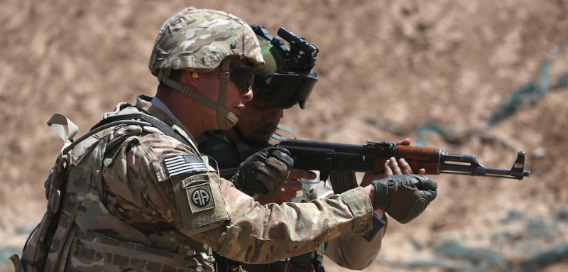 TAJI, IRAQ - APRIL 12:  A U.S. Army trainer (L), instructs an Iraqi Army recruit at a military base on April 12, 2015 in Taji, Iraq. U.S. forces, currently operating in 5 large bases throught the country, are training thousands of Iraqi Army combat troops, trying to rebuild a force they had origninally trained before the U.S. withdrawal from Iraq in 2010. Members of the U.S. Army's 5-73 CAV, 3BCT, 82nd Airborne Division are teaching members of the newly-formed 15th Division of the Iraqi Army, as the Iraqi government launches offensives to try to recover territory lost to ISIS last year.  (Photo by John Moore/Getty Images)