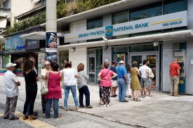 ATHENS, GREECE - JUNE 28:  Greeks queue in front of the National Bank to use ATM to withdraw cash on June 28, 2015 in Athens, Greece. Greece is anxiously awaiting a decision by the European Central Bank on whether to increase the emergency liquidity assistance banks can draw on from the country's central bank.  (Photo by Milos Bicanski/Getty Images)