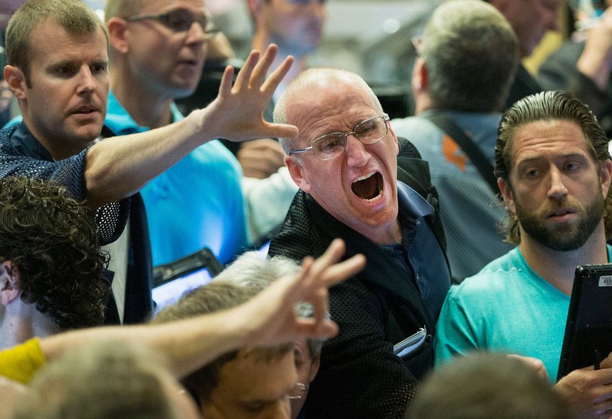 CHICAGO, IL - AUGUST 24:  Traders signal offers in the Standard & Poor's 500 stock index options pit at the Chicago Board Options Exchange (CBOE) on August 24, 2015 in Chicago, Illinois. Uncertainty among traders after big losses in the Asian markets caused a sharp drop in the S&P at the open.  (Photo by Scott Olson/Getty Images)