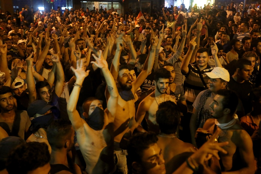 Lebanese protesters shout slogans during a demonstration against the ongoing trash crisis on August 25, 2015, in front of the seat of the government in central Beirut. Lebanon's cabinet ended an acrimonious meeting with no solution to the trash crisis that has sparked violent protests and calls for the government's resignation. AFP PHOTO / STR        (Photo credit should read -/AFP/Getty Images)