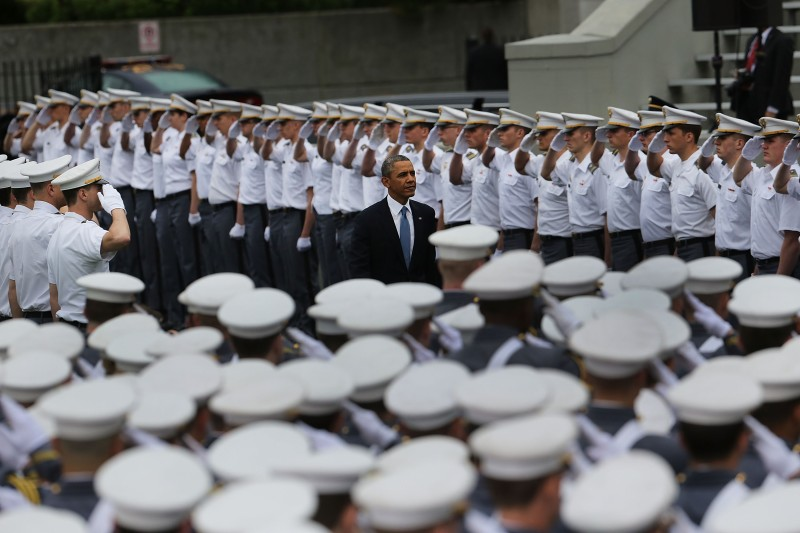 WEST POINT, NY - MAY 28: U.S. President Barack Obama enters the stadium at West Point to give the commencement address at the graduation ceremony at the U.S. Military Academy on May 28, 2014 in West Point, New York. In a highly anticipated speech on foreign policy, the President provided details on his plans for winding down America's military commitment in Afghanistan. Over 1,000 cadets are expected to graduate from the class of 2014 and will be commissioned as second lieutenants in the U.S. Army.  (Photo by Spencer Platt/Getty Images)
