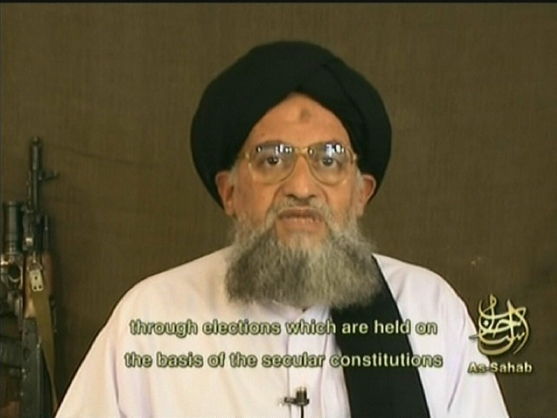-, -:  An image grab taken from a video broadcast on Al--Jazeera television 20 December 2006 shows Al-Qaeda number two Ayman al-Zawahiri saying that only jihad, not elections, can bring about the liberation of occupied Palestinian territory. Osama bin Laden's right-hand man slammed Hamas, without naming it, for recognizing Palestinian president Mahmud Abbas and taking part in elections on the basis of a secular constitution. The turbaned Egyptian-born Zawahiri frequently speaks for Al-Qaeda in video or audiotapes, some posted on internet sites, like As-Sahab, and others aired by Qatar-based Al-Jazeera. AFP PHOTO/AL-JAZEERA/AS-SAHAB  (Photo credit should read -/AFP/Getty Images)