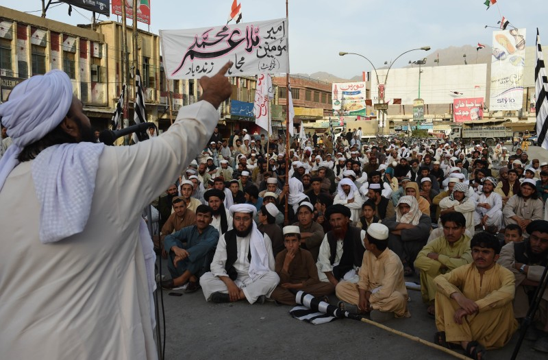 Pakistan members of Jamiat Nazriati party shout slogans in a rally to pay tribute to Afghanistan's deceased Taliban chief Mullah Omar, in Quetta on August 2, 2015. New Taliban leader Mullah Akhtar Mansour called for unity in the movement August 1, in his first audio message since becoming head of the group that faces deepening splits following the death of longtime chief Mullah Omar. AFP PHOTO / Banaras KHAN        (Photo credit should read BANARAS KHAN/AFP/Getty Images)