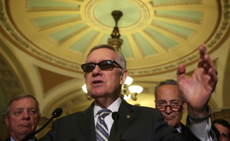 WASHINGTON, DC - JULY 14:  U.S. Senate Minority Leader Sen. Harry Reid (D-NV) (2nd L) speaks as (L-R) Senate Minority Whip Sen. Richard Durbin (D-IL) and Sen. Charles Schumer (D-NY) listen during a news briefing after the weekly Senate Democratic Policy Luncheon July 14, 2015 on Capitol Hill in Washington, DC. Senate Democrats had a meeting with Democratic U.S. presidential hopeful and former U.S. Secretary of State Hillary Clinton and discussed various topics including the Iran talks deal.  (Photo by Alex Wong/Getty Images)
