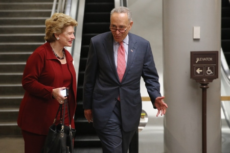 WASHINGTON, DC - JUNE 01: U.S. Sen. Debbie Stabenow (D-MI) (L) and U.S. Sen. Charles Schumer (D-NY) talk before boarding the Senate Subway at the U.S. Capitol June 1, 2015 in Washington, DC. In protest of the National Security Agency's sweeping program to collect U.S. citizens' telephone metadata, U.S. Sen. Rand Paul (R-KY) blocked an extension of some parts of the USA PATRIOT Act, allowing them to lapse at 12:01 a.m. Monday. The Senate will continue to work to restore the lapsed authorities by amending a House version of the bill and getting it to President Obama later this week. (Photo by Chip Somodevilla/Getty Images)