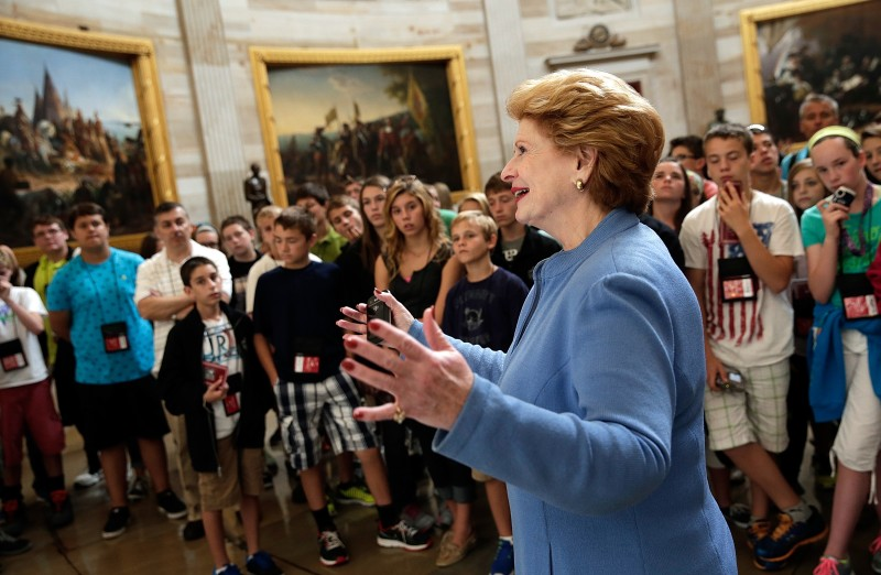 WASHINGTON, DC - OCTOBER 03: Senator Debbie Stabenow (D-MI) leads a tour of the Capitol October 3, 2013 in Washington, DC. Due to Capitol tour guides being furloughed, Senator Stabenow gave students from St. Patrick's School in White Lake, Michigan a tour of the Captitol's Rotunda. Congressional Democrats and Republicans remain gridlocked on funding appropriations for the federal government as the shutdown enters its third day. (Photo by Win McNamee/Getty Images)