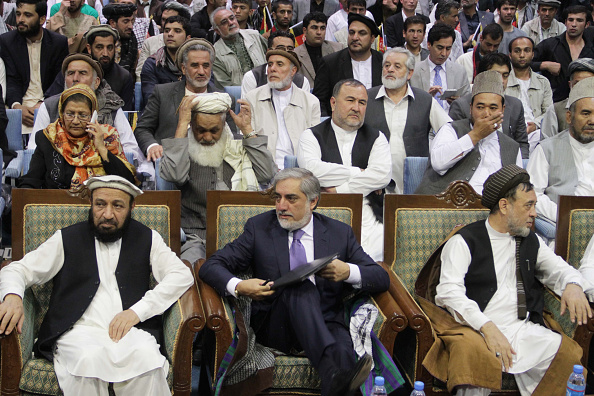 KABUL, AFGHANISTAN - SEPTEMBER 25: Abdullah Abdullah (C), former Afghani presidential candidate attends a gathering in Kabul Afghanistan on September 25, 2014. Abdullah Abdullah congratulated President-elect Ashraf Ghani Ahmadzai on his victory in the country's general election and vowed to support him in a national unity government. (Photo by Haroon Sabawoon / Anadolu Agency / Getty Images)