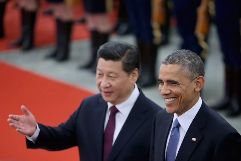 BEIJING, CHINA - NOVEMBER 12:  Chinese President Xi Jinping (L) accompanies U.S. President Barack Obama (R) to view an honour guard during a welcoming ceremony outside the Great Hall of the People on November 12, 2014 in Beijing, China. U.S. President Barack Obama pays a state visit to China after attending the 22nd Asia-Pacific Economic Cooperation (APEC) Economic Leaders' Meeting.  (Photo by Feng Li/Getty Images)