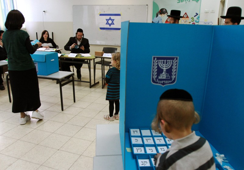 Israeli ultra-orthodox Jewish residents arrive to cast their ballot at a polling station in Bnei Brak, near the city of Tel Aviv, on March 17, 2015. Israelis are voting in a close-fought election pitting the centre left against Prime Minister Benjamin Netanyahu, who ruled out a Palestinian state in a last-ditch appeal to the far-right. AFP PHOTO / GIL COHEN-MAGEN        (Photo credit should read GIL COHEN MAGEN/AFP/Getty Images)