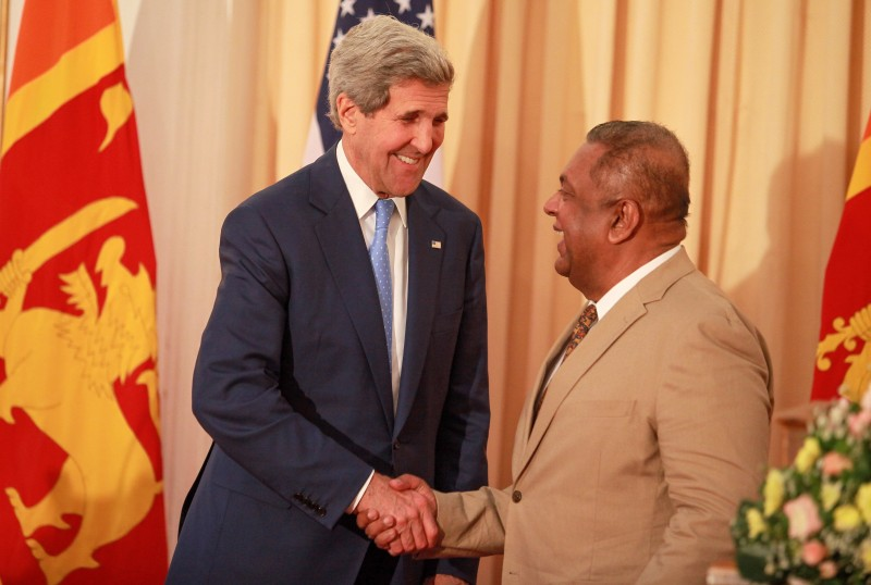 COLOMBO, SRI LANKA - MAY 02 :  U.S. Secretary of State John Kerry, left, shakes hands with Sri Lankan Foreign Minister Mangala Samaraweera during a news conference following a meeting at the Ministry of Foreign Affairs in Colombo, Sri Lanka, Saturday, May 2, 2015. (Photo by Chamila Karunarathne/Anadolu Agency/Getty Images)