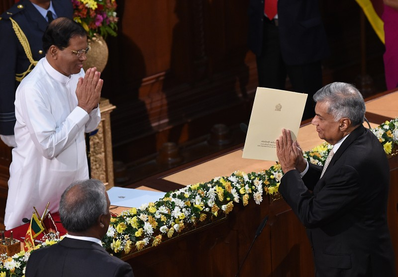 Sri Lanka's Prime Minister Ranil Wickremesinghe (R) after taking an oath as he is sworn in as minister of policy planning and economic affairs in front of Sri Lanka's President Maithripala Sirisena  in Colombo on September 4, 2015. Sri Lanka's President September 4 formed a unity government with 42 ministers, a day after parliament endorsed the move as part of efforts to address ethnic reconciliation after decades of war. Maithripala Sirisena gave a majority of portfolios to Prime Minister Ranil Wickremesinghe's United National Party (UNP) which won the August 17 general elections. AFP PHOTO / Ishara S. KODIKARA        (Photo credit should read Ishara S.KODIKARA/AFP/Getty Images)