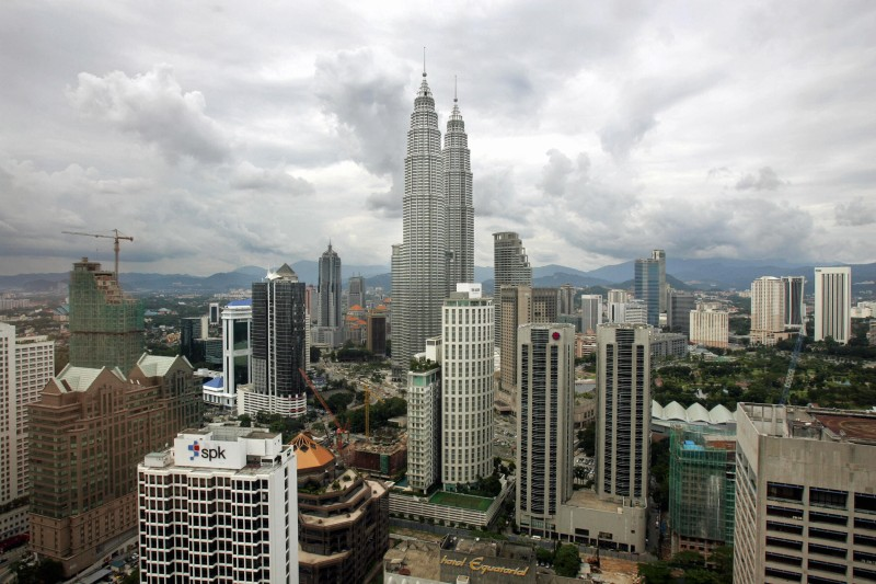 KUALA LUMPUR, MALAYSIA:  Photo shows the Petronas Twin Towers amongst the skyline of Kuala Lumpur 12 April 2005. A prolonged downturn in the global semiconductor industry, high oil prices and rising interest rates could push economic growth to as low as five percent this year, said Malaysia's central bank.  AFP PHOTO / Jimin LAI  (Photo credit should read JIMIN LAI/AFP/Getty Images)