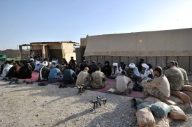 US Marines from 1st Battalion 7th Marines Regiment hold a shura meeting with local police and residents at PB Fulod in Sangin on June 12, 2012.  The US-led war in Afghanistan has cost the lives of around 3,000 US and allied troops, seen thousands of Afghans killed and cost hundreds of billions of dollars.  AFP PHOTO / ADEK BERRY        (Photo credit should read ADEK BERRY/AFP/GettyImages)