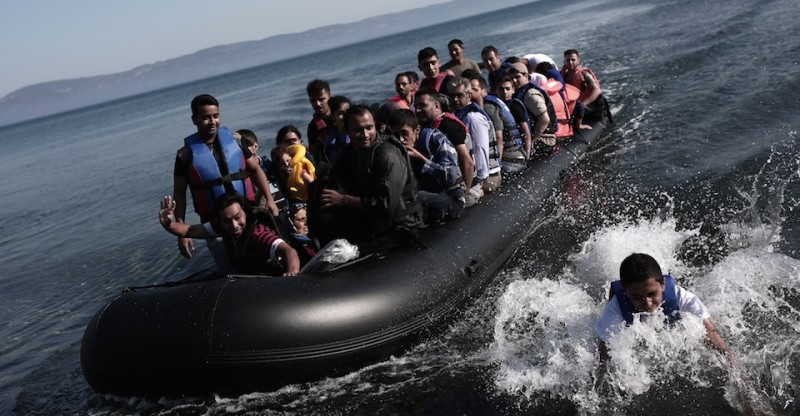 Refugees coming from Turkey land on the shores of the Greek island Lesbos in an inflatable boat on September 4, 2015. More than 230,000 refugees and migrants have arrived in Greece by sea this year, a huge rise from 17,500 in the same period in 2014, deputy shipping minister Nikos Zois said on September 3. AFP PHOTO / ANGELOS TZORTZINIS        (Photo credit should read ANGELOS TZORTZINIS/AFP/Getty Images)