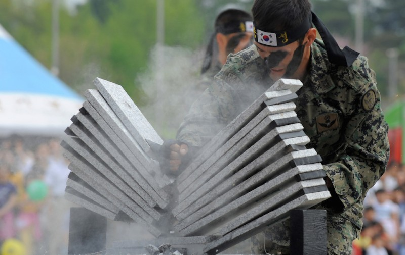 South Korean army commandos smash a pile of stone plates in a show of force at the national war museum in Seoul on May 5, 2010 marking children's day.  North Korea has completed deployment of about 50,000 special forces along the border with South Korea, a report said Wednesday, amid high tensions over the sinking of a Seoul warship          AFP PHOTO / PARK JI-HWAN (Photo credit should read PARK JI-HWAN/AFP/Getty Images)