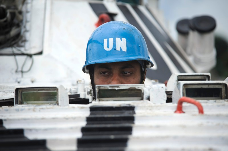 An Indian United Nations peacekeeper sits in an armoured infantry fighting vehicle at a temporary operating base in Bunagana, a border town in the Democratic Republic of the Congo on May 16, 2012. The United Nations Mission for the Stablisation of the Congo (MONUSCO) is conducting patrols in and around Bunagana, under its mandate to protect civilians against the recent clashes between the Congolese armed forces and mutinous rebels around Bunagana over the past ten days. AFP PHOTO/PHIL MOORE        (Photo credit should read PHIL MOORE/AFP/GettyImages)