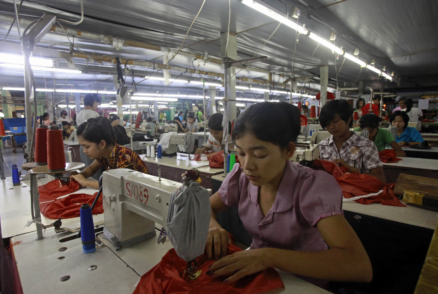 Myanmar labourers work at a garment factory on the outskirts of Yangon on September 27, 2012.  Washington is to ease a ban on imports from Myanmar, US Secretary of State Hillary Clinton said, lifting its last major trade embargo in a move swiftly welcomed in the former pariah state on September 27.     AFP PHOTO/ Ye Aung Thu        (Photo credit should read Ye Aung Thu/AFP/GettyImages)