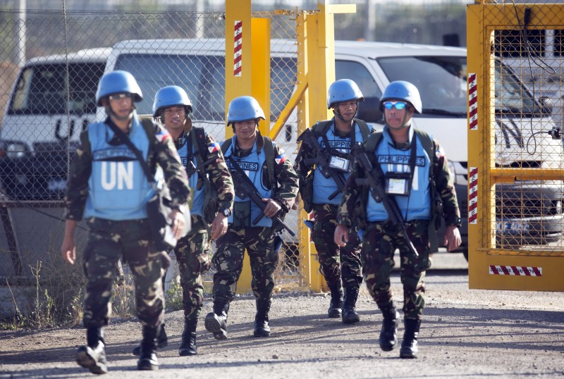 United Nations (UN) peacekeepers from the Philippines cross the Israeli army crossing of Quneitra between Syria to the Israeli annexed Golan Heights on June 12, 2013, on their way for a vacation after serving in Syria. AFP PHOTO/MENAHEM KAHANA        (Photo credit should read MENAHEM KAHANA/AFP/Getty Images)