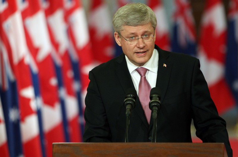 Canadian Prime Minister Stephen Harper addresses media alongside Australian Prime Minister Tony Abbott (not pictured) during a joint press conference in Parliament Hill in Ottawa, Canda on June 9, 2014. AFP PHOTO/ Cole BURSTON        (Photo credit should read Cole Burston/AFP/Getty Images)