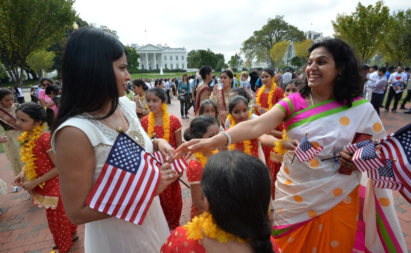 Indian people living in the US gather in support outside the White House, where Indian Prime Minister Narendra Modi met with US President Barack Obama in Washington, DC, on September 30, 2014. Modi launched his Washington visit late on Monday at a private dinner hosted by Obama and Vice President Joe Biden in the ornate Blue Room of the White House. He came to Washington after wowing members of the Indian diaspora in New York and making his debut at the United Nations General Assembly, following his Bharatiya Janata Party's (BJP) landslide election win in May. AFP PHOTO/MLADEN ANTONOV        (Photo credit should read MLADEN ANTONOV/AFP/Getty Images)