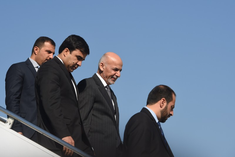 Visiting Afghan President Ashraf Ghani (2nd R) alights from his aircraft at the Nur Khan air base in Rawalpindi on November 14, 2014. Afghan President Ashraf Ghani arrived for his first visit to neighbouring Pakistan, seeking to improve ties crucial to his hopes of reviving Taliban peace talks as US troops end their 13-year war.  AFP PHOTO/Farooq NAEEM        (Photo credit should read FAROOQ NAEEM/AFP/Getty Images)