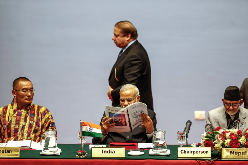 KATHMANDU, NEPAL - NOVEMBER 26:  Nawaz Sharif, Prime Minister of Pakistan, walks behind Indian Prime Minister Narendra Modi during the inaugural session of the 18th SAARC Summit on November 26, 2014 in Kathmandu, Nepal. Nepal is hosting the 18th South Asian Association for Regional Cooperation (SAARC) Summit in Kathmandu, which will be attended by leaders of Afghanistan, Bangladesh, Pakistan, India, the Maldives, Sri Lanka, Bhutan and Nepal.  Nepal is hosting the SAARC Summit for the third time, which was first held in Dhaka, Bangladesh in 1985. Some of the key issues to be discussed during the Summit will include three key framework agreements between SAARC countries to enhance rail and road connectivity and to set up a regional power grid. (Photo by Narendra Shrestha - Pool/Getty Images)