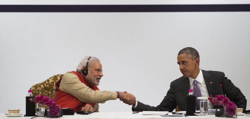 Indian Prime Minister Narendra Modi and US President Barack Obama shake hands during the India-US Business Summit in New Delhi on January 26, 2015. Rain failed to dampen spirits at India's Republic Day parade January 26 as Barack Obama became the first US president to attend the spectacular military and cultural display in a sign of the nations' growing closeness. AFP PHOTO / SAUL LOEB        (Photo credit should read SAUL LOEB/AFP/Getty Images)