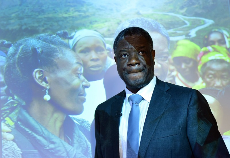 """Congolese gynaecologist Denis Mukwege, laureate of the 2014 Sakharov Prize, addresses a press conference to present the documentary """"The Man Who Mends Women - the Wrath of Hippocrates"""", in Brussels, March 25, 2015. The documentary, from co-authors Thierry Michel and Colette Braeckman, follows Mukwege's efforts to repair the physical and psychological injuries of rape victims, and denounces the routine use of sexual violence by armed forces and militia groups in eastern Democratic Republic of Congo against women. AFP PHOTO/Emmanuel Dunand        (Photo credit should read EMMANUEL DUNAND/AFP/Getty Images)"""