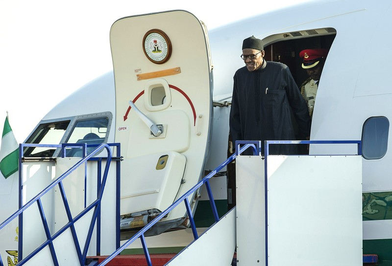 Nigerian President Muhammadu Buhari disembarks upon arrival at the Waterkloof Military air base in Pretoria, on June 13, 2015 for the 25th African Union Summit held in Johannesburg. Despite growing pressure to address the tragedy of African migrants drowning in the Mediterranean, the African Union is unlikely to offer any home-grown solutions to the crisis, say analysts. AFP PHOTO/MUJAHID SAFODIEN        (Photo credit should read MUJAHID SAFODIEN/AFP/Getty Images)