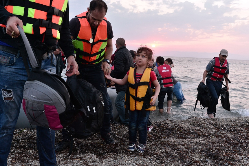 Syrian people disembark on the island of Lesbos, early on June 18, 2015. Some 48,000 migrants and refugees have landed on Greek shores so far this year, compared to 34,000 arrivals during all of 2014, according to the International Organization for Migration (IOM). AFP PHOTO / LOUISA GOULIAMAKI        (Photo credit should read LOUISA GOULIAMAKI/AFP/Getty Images)