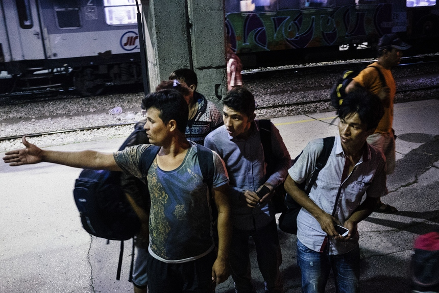 Migrants coming from Afghanistan wait at the Nis railway station, southern Serbia, for a train heading north to Belgrade, early on July 18, 2015. Illegal immigrants cross Serbia on their way to other European countries as it has land access to four members of the 28-nation bloc -- Hungary, Bulgaria, Romania and Croatia. Over the last two years, Hungary has been one of the main routes for people hoping to cross into Austria and Germany, most coming from Afghanistan, Iraq, Syria and African countries. AFP PHOTO / DIMITAR DILKOFF        (Photo credit should read DIMITAR DILKOFF/AFP/Getty Images)