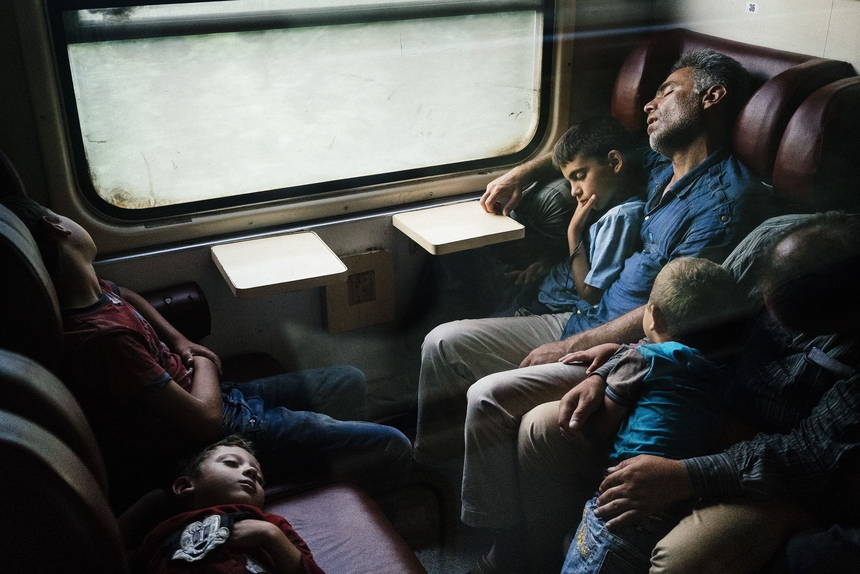 Migrants sleep on a train heading north from Nis to Belgrade, early on July 18, 2015. Illegal immigrants cross Serbia on their way to other European countries as it has land access to four members of the 28-nation bloc -- Hungary, Bulgaria, Romania and Croatia. Over the last two years, Hungary has been one of the main routes for people hoping to cross into Austria and Germany, most coming from Afghanistan, Iraq, Syria and African countries. AFP PHOTO / DIMITAR DILKOFF        (Photo credit should read DIMITAR DILKOFF/AFP/Getty Images)