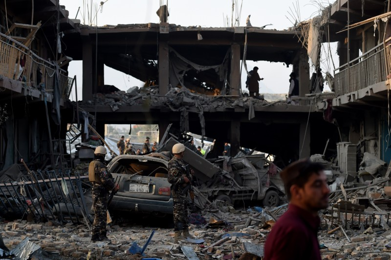 Afghan security forces inspect the site after a powerful truck bomb het  in Kabul on August 7, 2015. A powerful truck bomb killed at least seven people and wounded more than 100 others, officials said, the first major attack in the Afghan capital since the announcement of Taliban leader Mullah Omar's death. AFP PHOTO / Wakil Kohsar        (Photo credit should read WAKIL KOHSAR/AFP/Getty Images)