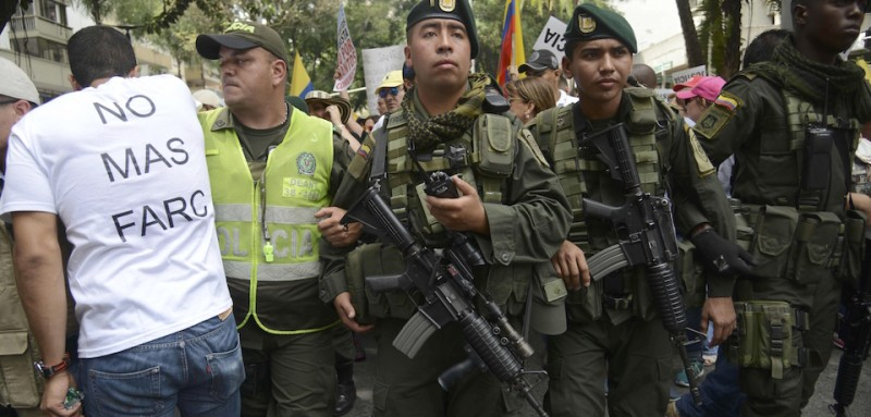 Soldiers patrol during a march on August 7, 2015, in Cali, Colombia against the government of president Juan Manuel Santos and the ongoing peace process with the Revolutionary Armed Forces of Colombia (FARC) guerrillas. AFP PHOTO / RAUL ARBOLEDA        (Photo credit should read RAUL ARBOLEDA/AFP/Getty Images)