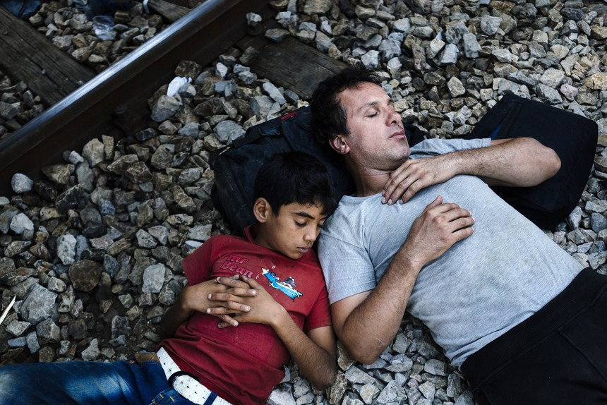 Migrants take a nap in the shade at the train station of Gevgelija on the Macedonian-Greek border from where they hope to catch a train heading to the border with Serbia on August 13, 2015. The number of migrants fleeing war and poverty in the Middle East and Africa to Europe has jumped in recent months and years as instability has gripped Syria, Iraq and North Africa.  AFP PHOTO / DIMITAR DILKOFF        (Photo credit should read DIMITAR DILKOFF/AFP/Getty Images)