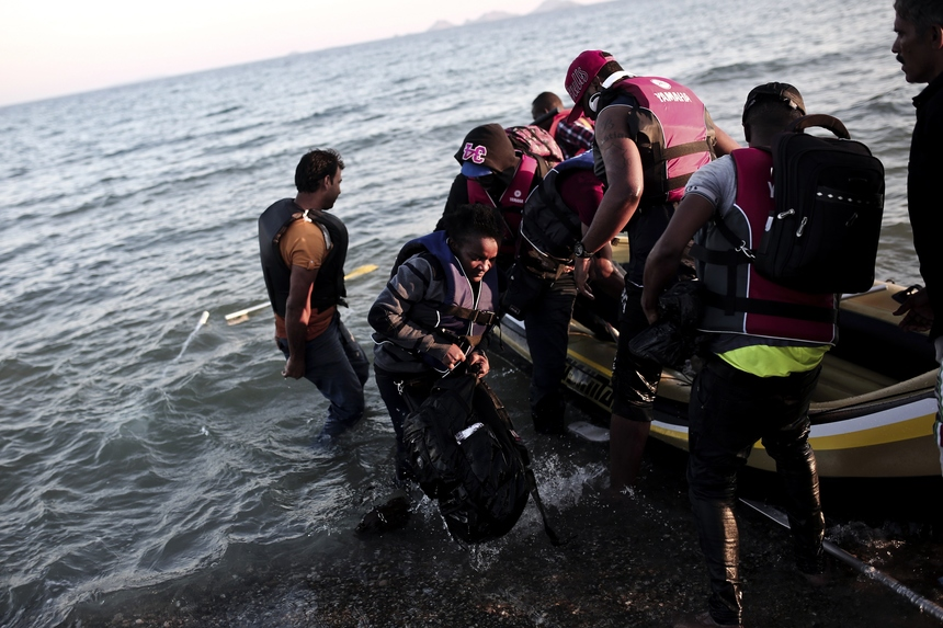Migrants arrive on the shore of Kos island after crossing from Turkey on a small dinghy on August 19, 2015. The UN refugee agency said in the last week alone, 20,843 migrants -- virtually all of them fleeing war and persecution in Syria, Afghanistan and Iraq -- arrived in Greece, which has seen around 160,000 migrants land on its shores since January, according to the UN refugee agency.  AFP PHOTO / ANGELOS TZORTZINIS        (Photo credit should read ANGELOS TZORTZINIS/AFP/Getty Images)