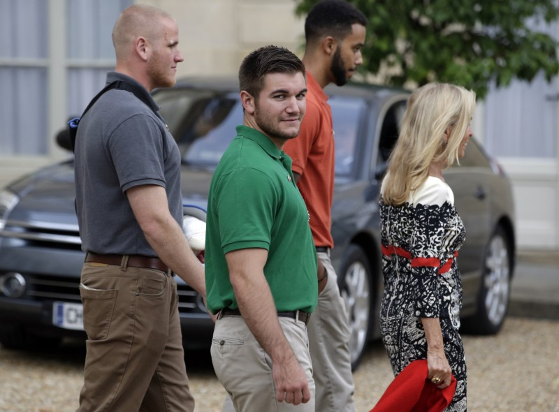 (LtoR) Off-duty US servicemen Spencer Stone, Alek Skarlatos and Anthony Sadler together with US ambassador to France Jane Hartley leave after a reception at the Elysee Palace in Paris on August 24, 2015, after having been awarded with France's top Legion d'Honneur medal by the French president in recognition of their bravery after they overpowered the train attacker. AFP PHOTO / KENZO TRIBOUILLARD         (Photo credit should read KENZO TRIBOUILLARD/AFP/Getty Images)