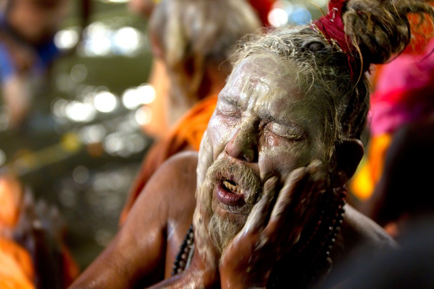 NASHIK, INDIA - AUGUST 29: Sadhus take holy dip during the first Shahi Snan of Simhastha Kumbh Mela at Kushwarth Kund, Trimbakeshwar on August 29, 2015 in Nashik, India. The Nashik Kumbh Mela is generally acknowledged to be the most sacred of all the Hindu festivals. Kumbh Mela is a Hindu pilgrimage of faith in which Hindus gather to bathe in a sacred river. Kumbh means a pitcher and Mela means fair in Hindi. The pilgrimage is held for 13 months after every 12 years in Nasik city in Maharashtra state of India. The Kumbh Mela is marked by millions of devotees' plunge into the river Godavari that is believed, it would cleanse their souls leading to salvation. A ritual bath at predetermined time and place is the major event of the festival. (Photo by Satish Bate/Hindustan Times via Getty Images)